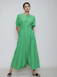 green jumpsuit, black flats, tied hair